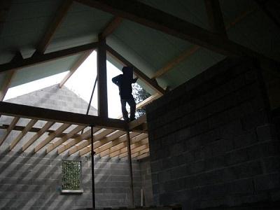 Charpente traditionnelle avec isolation en sarking, isolation posée par dessus la charpente